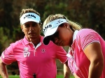 Bernhard Langer and Christine Langer line up a putt